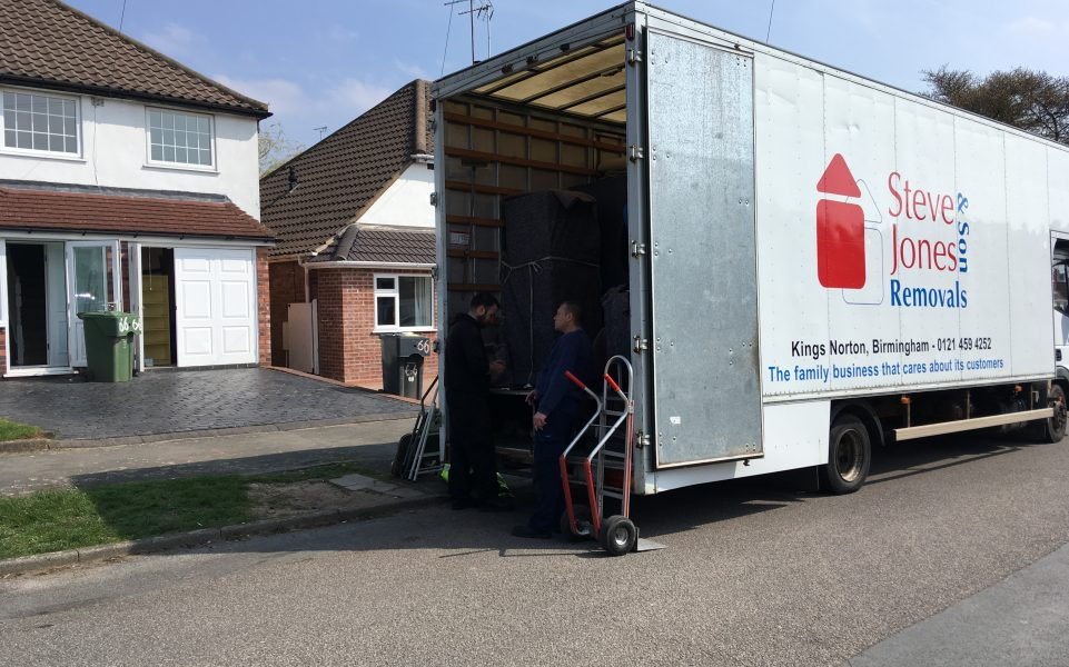 Kings Norton removals firm lorry with doors open for loading